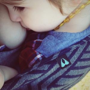 Baby feeding in a sling